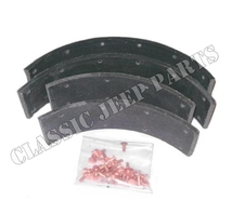 "Brake shoe lining with rivets 2 wheels with brake shoes with 1 3/16"" between rivet holes"